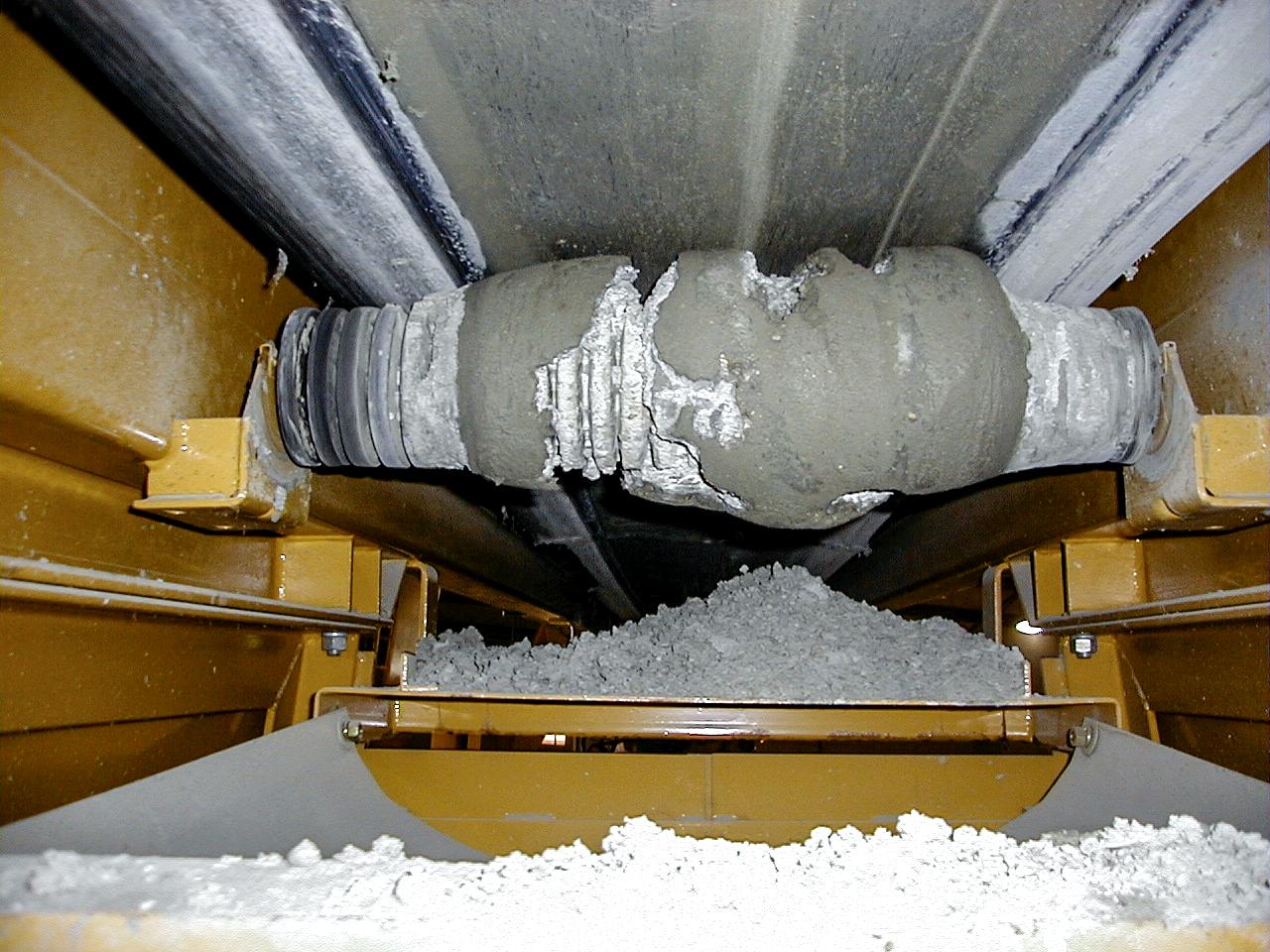 material carryback on return roller