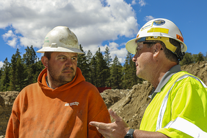 Martin Engineering vibration expert Larry Horrie discusses a solution with Trey Poulson.