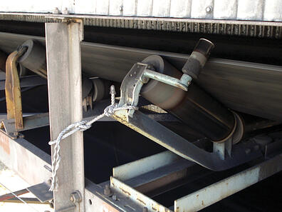Tying off a conveyor idler is sometimes used to try to put the conveyor belt in line
